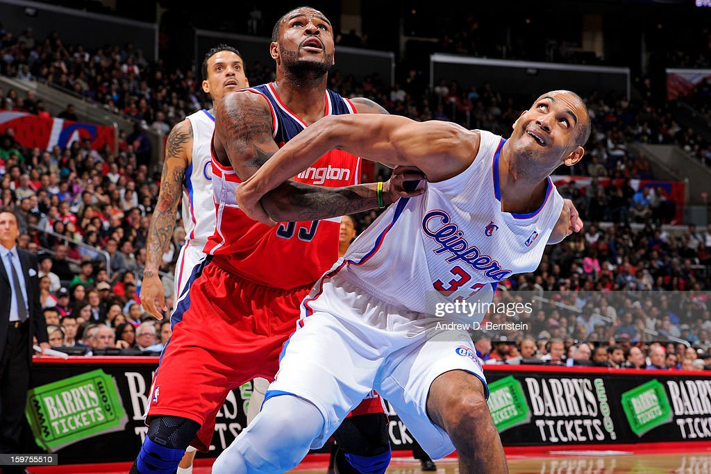 Grant Hill #33 of the Los Angeles Clippers battles for rebound position against Trevor Booker #35 of the Washington Wizards at Staples Center on January 19, 2013 in Los Angeles, California.