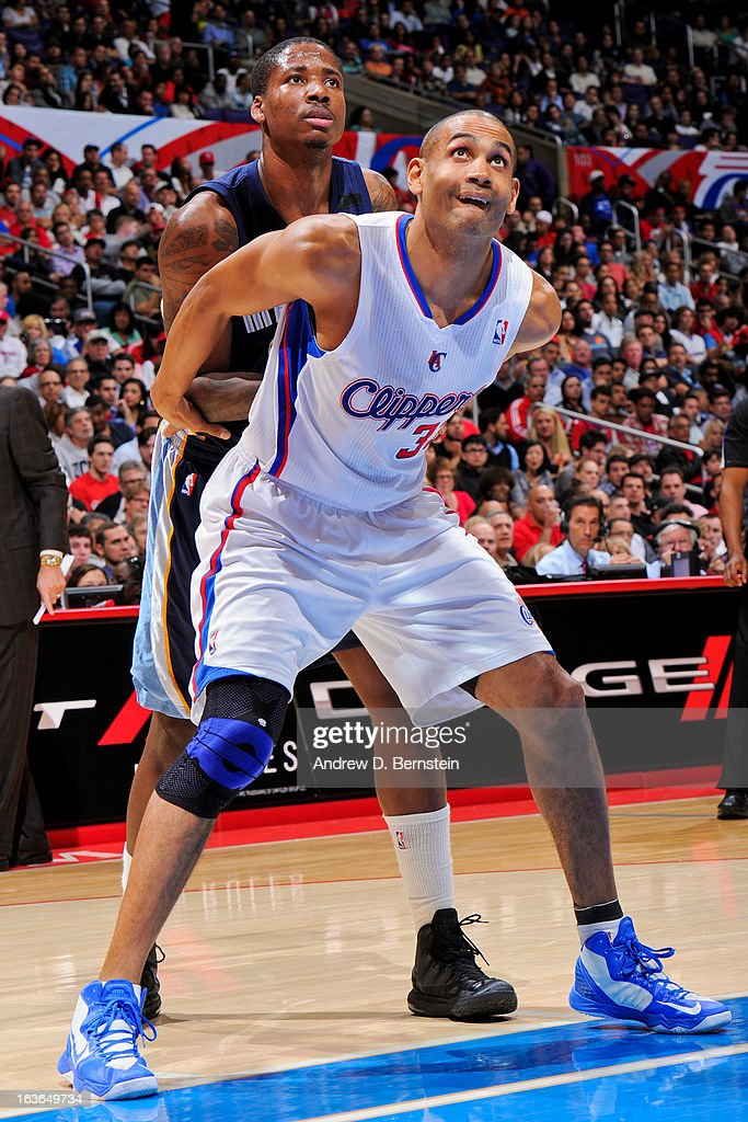 Grant Hill #33 of the Los Angeles Clippers battles for rebound position against Ed Davis #32 of the Memphis Grizzlies at Staples Center on March 13, 2013 in Los Angeles, California.