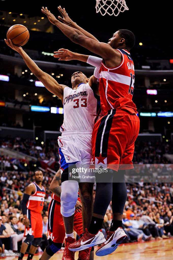 Grant Hill #33 of the Los Angeles Clippers drives to the basket against Kevin Seraphin #13 of the Washington Wizards at Staples Center on January 19, 2013 in Los Angeles, California.
