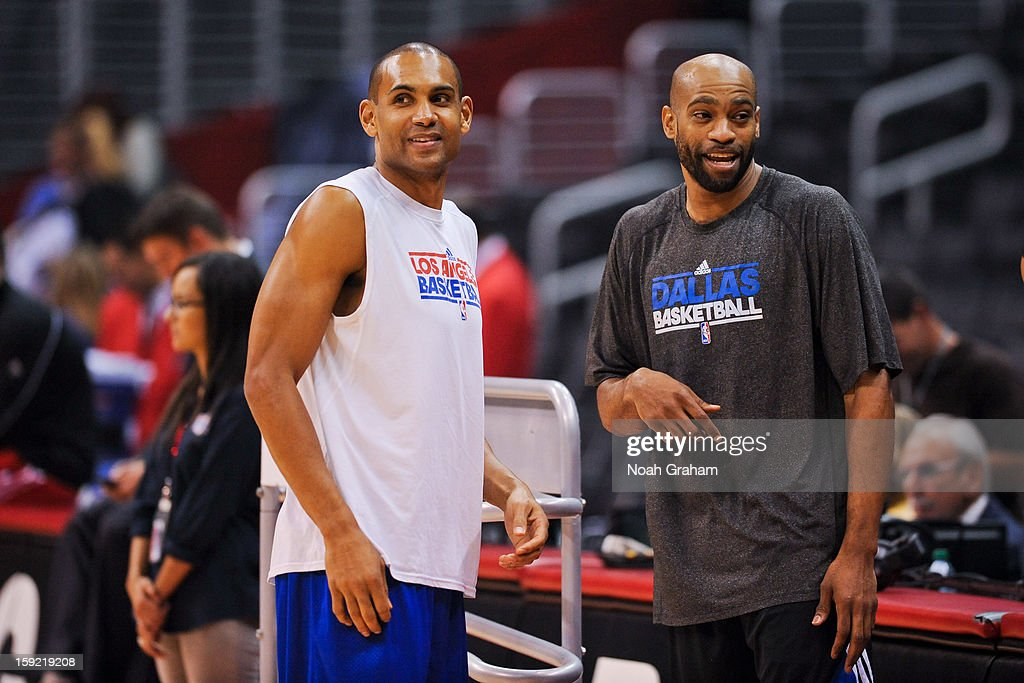 Grant Hill #33 of the Los Angeles Clippers shares a laugh with Vince Carter #25 of the Dallas Mavericks before their game at Staples Center on January 9, 2013 in Los Angeles, California.