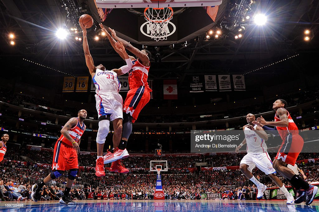 Grant Hill #33 of the Los Angeles Clippers shoots a layup against Kevin Seraphin #13 of the Washington Wizards at Staples Center on January 19, 2013 in Los Angeles, California.