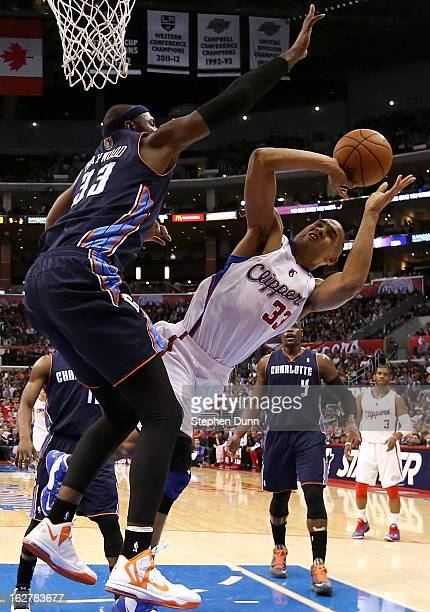 Grant Hill of the Los Angeles Clippers shoots and draws a foul from Brendan Haywood of the Charlotte Bobcats at Staples Center on February 26 2013 in...