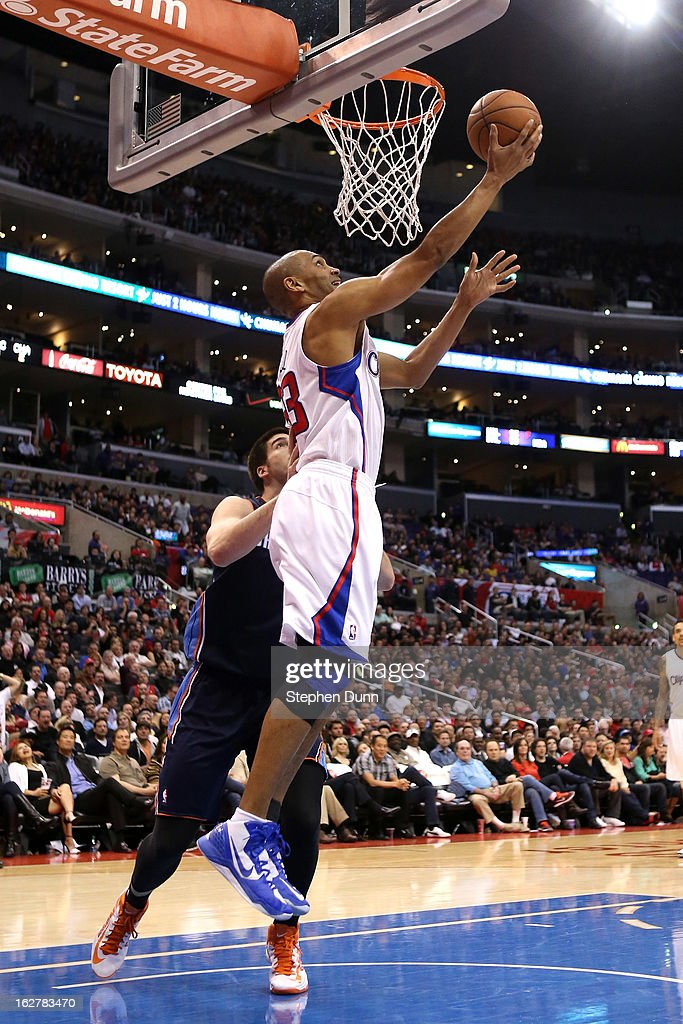 Grant Hill #33 of the Los Angeles Clippers shoots over Byron Mullens #22 of the Charlotte Bobcats at Staples Center on February 26, 2013 in Los Angeles, California. The Clippers won 106-84.