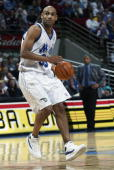 Grant Hill of the Orlando Magic drives upcourt during the game against the Detroit Pistons at TD Waterhouse Centre on December 25 2002 in Orlando...