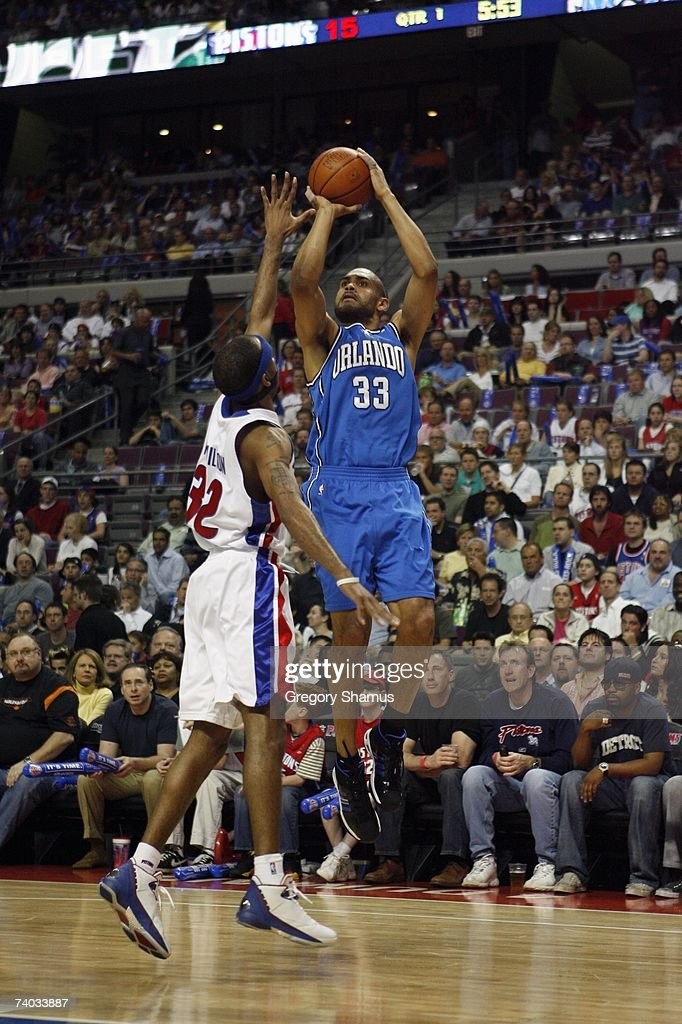 Grant Hill #33 of the Orlando Magic shoots over Richard Hamilton #32 of the Detroit Pistons in Game Two of the Eastern Conference Quarterfinals during the 2007 NBA Playoffs at the Palace of Auburn Hills on April 23, 2007 in Auburn Hills, Michigan. The Pistons won 98-90.