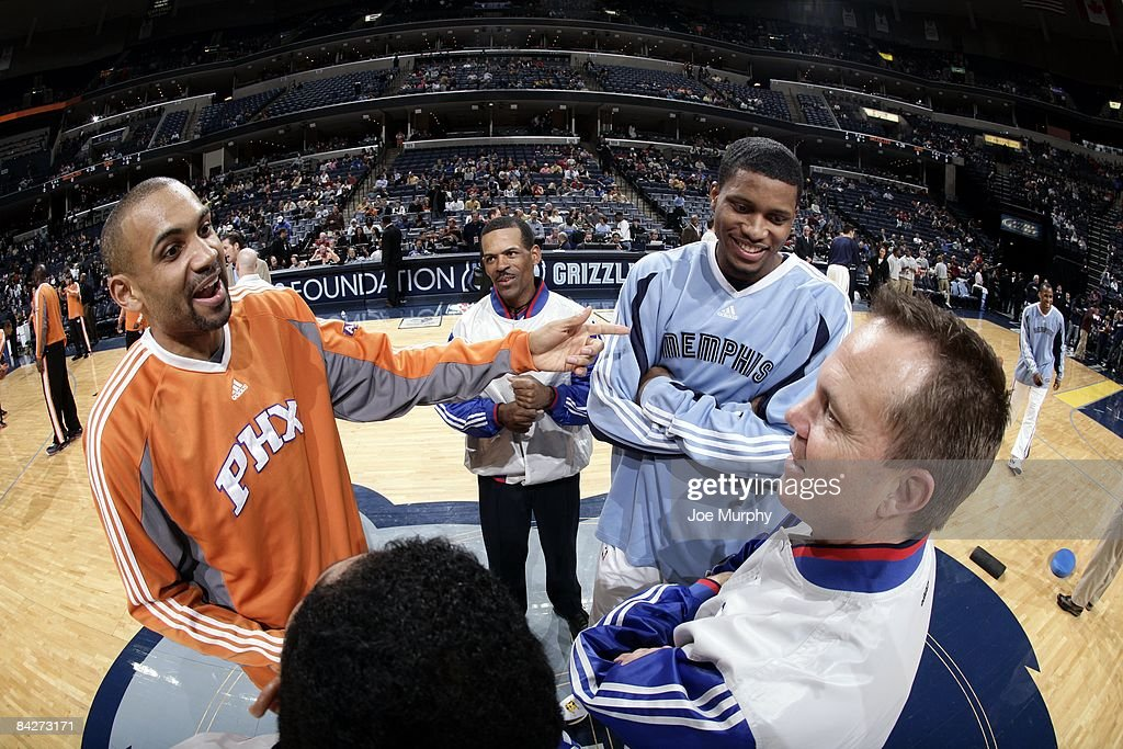 Grant Hill of the Phoenix Suns and Rudy Gay of the Memphis Grizzlies talk with NBA referee's Eric Lewis and Bill Spooner prior to their game at the...