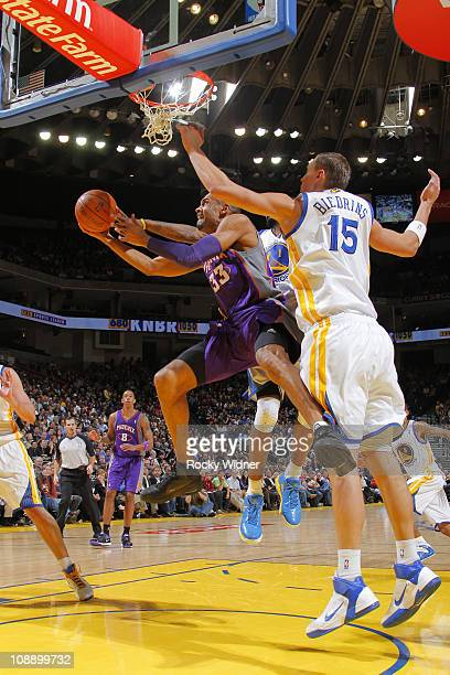 Grant Hill of the Phoenix Suns attempts a reverse layup against Andris Biedrins of the Golden State Warriors on February 7 2011 at Oracle Arena in...
