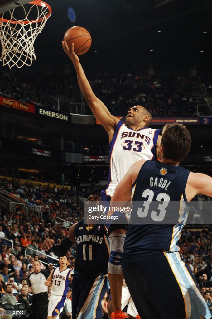 <a gi-track='captionPersonalityLinkClicked' href=/galleries/search?phrase=Grant+Hill+-+Basketball+Player&family=editorial&specificpeople=201658 ng-click='$event.stopPropagation()'>Grant Hill</a> #33 of the Phoenix Suns drives for a layup past <a gi-track='captionPersonalityLinkClicked' href=/galleries/search?phrase=Marc+Gasol&family=editorial&specificpeople=661205 ng-click='$event.stopPropagation()'>Marc Gasol</a> #33 of the Memphis Grizzlies in an NBA game played on March 10, 2012 at U.S. Airways Center in Phoenix, Arizona.