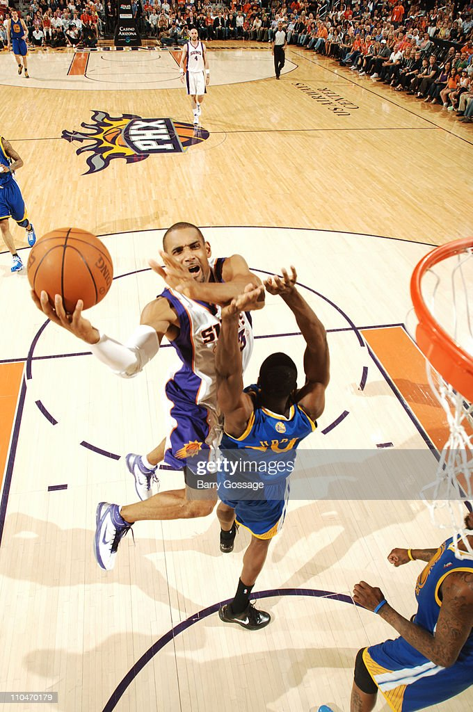 <a gi-track='captionPersonalityLinkClicked' href=/galleries/search?phrase=Grant+Hill+-+Basketball+Player&family=editorial&specificpeople=201658 ng-click='$event.stopPropagation()'>Grant Hill</a> #33 of the Phoenix Suns drives for a shot against <a gi-track='captionPersonalityLinkClicked' href=/galleries/search?phrase=Ekpe+Udoh&family=editorial&specificpeople=4185351 ng-click='$event.stopPropagation()'>Ekpe Udoh</a> #20 of the Golden State Warriors in an NBA game played on March 18, 2011 at U.S. Airways Center in Phoenix, Arizona.