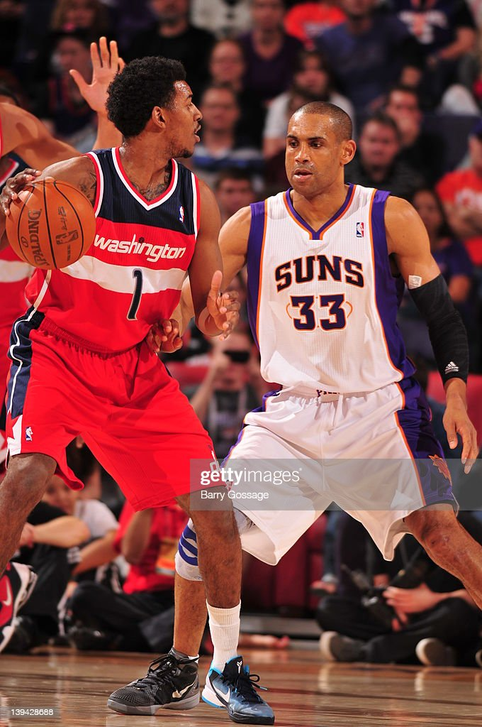 Grant Hill #33 of the Phoenix Suns guards Nick Young #1 of the Washington Wizards in an NBA game played on February 20, 2012 at U.S. Airways Center in Phoenix, Arizona.