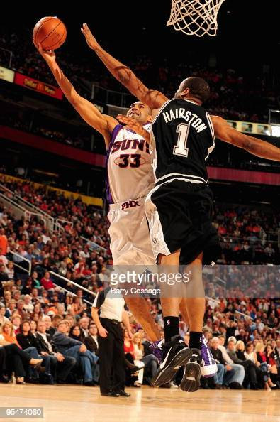 Grant Hill of the Phoenix Suns lays the ball up against Malik Hairston of the San Antonio Spurs during the game on December 15 2009 at US Airways...