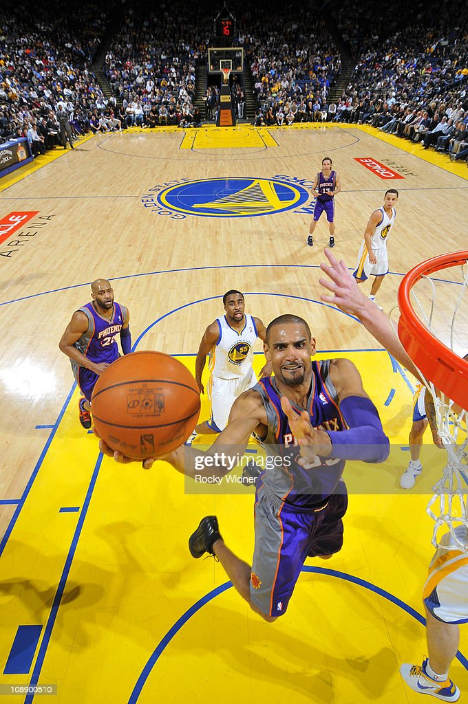 <a gi-track='captionPersonalityLinkClicked' href=/galleries/search?phrase=Grant+Hill+-+Basketball+Player&family=editorial&specificpeople=201658 ng-click='$event.stopPropagation()'>Grant Hill</a> #33 of the Phoenix Suns lays the ball up against the Golden State Warriors on February 7, 2011 at Oracle Arena in Oakland, California.
