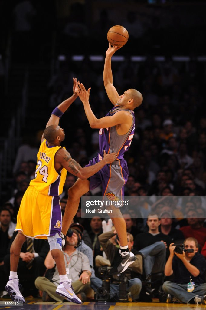 Grant Hill #33 of the Phoenix Suns shoots against Kobe Bryant #24 of the Los Angeles Lakers at Staples Center on December 10, 2008 in Los Angeles, California.