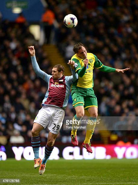 Grant Holt of Aston Villa challenges Russell Martin of Norwich City in the air for the ball during the Barclays Premier League match between Aston...