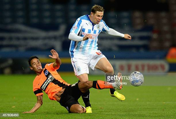 Grant Holt of Huddersfield is tackled by Adam Chicksen of Brighton during the Sky Bet Championship match between Huddersfield Town and Brighton Hove...