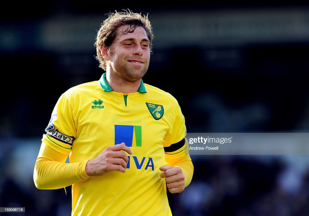Grant Holt of Liverpool smiles during the Barclays Premier League match between Norwich City and Liverpool at Carrow Road on September 29, 2012 in Norwich, England.