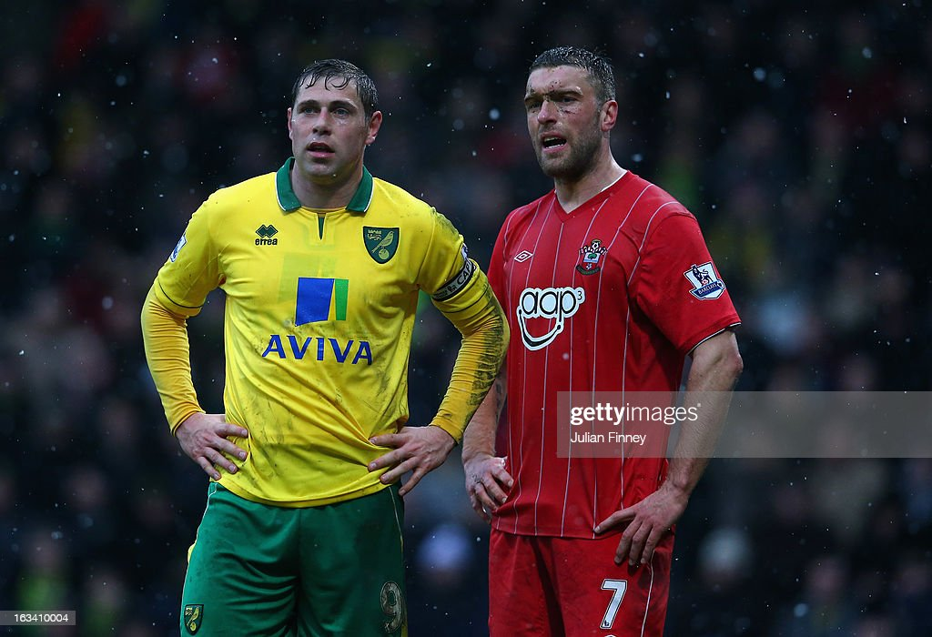 Grant Holt of Norwich City and Rickie Lambert of Southampton look on during the Barclays Premier League match between Norwich City and Southampton at Carrow Road on March 9, 2013 in Norwich, England.