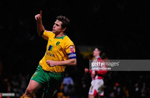 Grant Holt of Norwich City celebrates his second goal during the Coca Cola League One match between Norwich City and Exeter City at Carrow Road on...