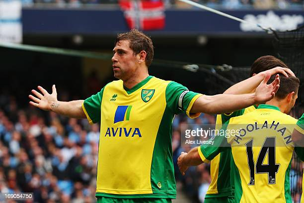 Grant Holt of Norwich City celebrates scoring during the Barclays Premier League match between Manchester City and Norwich City at Etihad Stadium on...