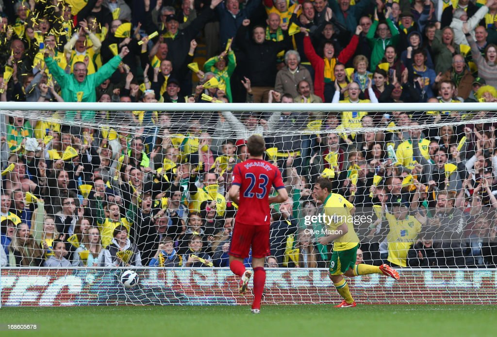 <a gi-track='captionPersonalityLinkClicked' href=/galleries/search?phrase=Grant+Holt&family=editorial&specificpeople=2091078 ng-click='$event.stopPropagation()'>Grant Holt</a> of Norwich City scores during the Barclays Premier League match between Norwich City and West Bromwich Albion at Carrow Road on May 12, 2013 in Norwich, England.