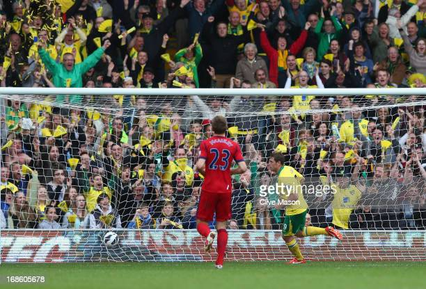 Grant Holt of Norwich City scores during the Barclays Premier League match between Norwich City and West Bromwich Albion at Carrow Road on May 12...