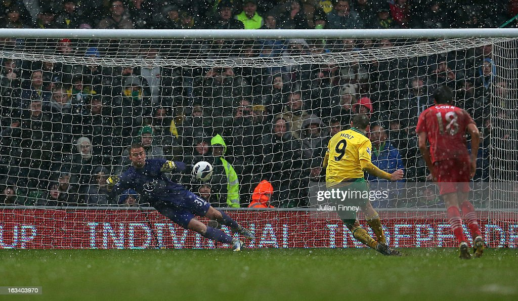 Grant Holt of Norwich City takes a penalty as the Southampton goalkeeper, Artur Boruc saves in the last minute during the Barclays Premier League match between Norwich City and Southampton at Carrow Road on March 9, 2013 in Norwich, England.