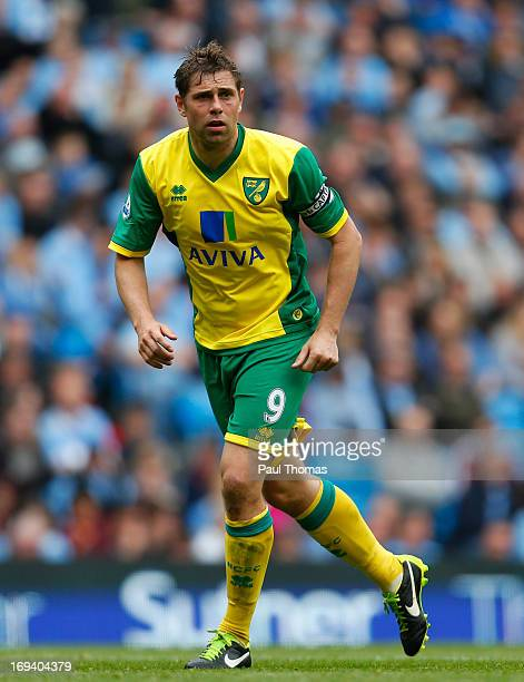 Grant Holt of Norwich in action during the Barclays Premier League match between Manchester City and Norwich City at the Etihad Stadium on May 19...