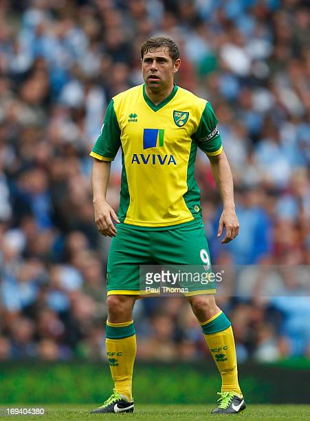 Grant Holt of Norwich watches on during the Barclays Premier League match between Manchester City and Norwich City at the Etihad Stadium on May 19...