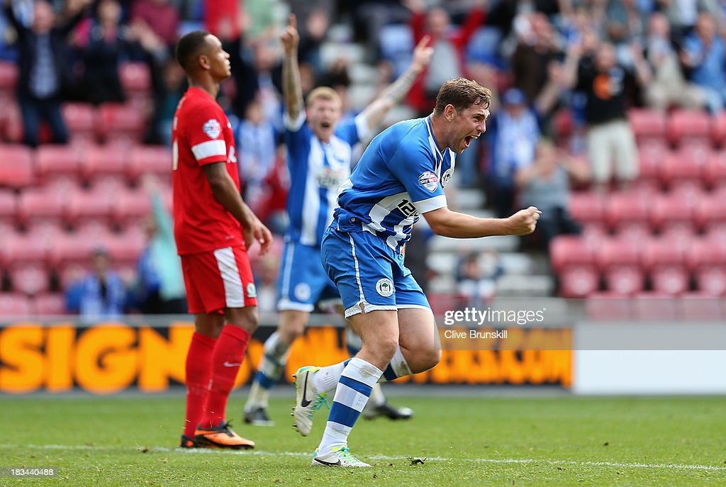 <a gi-track='captionPersonalityLinkClicked' href=/galleries/search?phrase=Grant+Holt&family=editorial&specificpeople=2091078 ng-click='$event.stopPropagation()'>Grant Holt</a> of Wigan Athletic celebrates after scoring his teams first goal and equaliser during the Sky Bet Championship match between Wigan Athletic and Blackburn Rovers at DW Stadium on October 6, 2013 in Wigan, England.