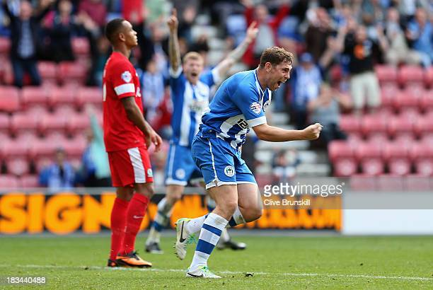 Grant Holt of Wigan Athletic celebrates after scoring his teams first goal and equaliser during the Sky Bet Championship match between Wigan Athletic...