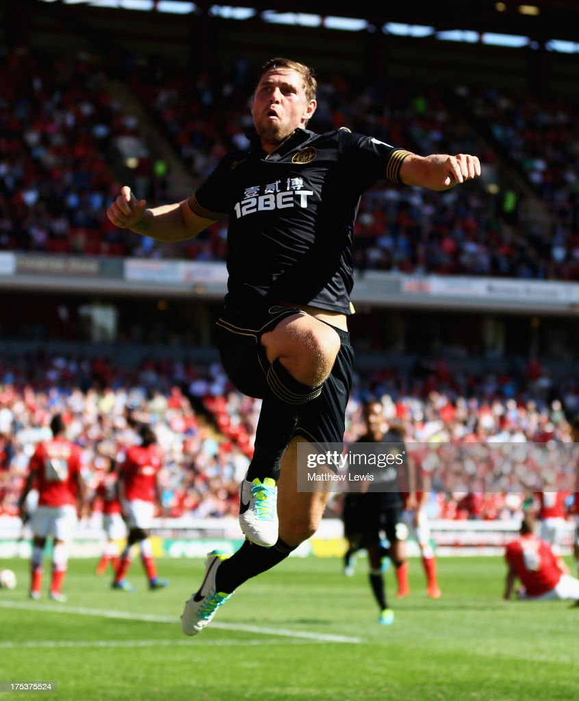 <a gi-track='captionPersonalityLinkClicked' href=/galleries/search?phrase=Grant+Holt&family=editorial&specificpeople=2091078 ng-click='$event.stopPropagation()'>Grant Holt</a> of Wigan Athletic celebrates his goal during the Sky Bet Championship match between Barnsley and Wigan Athletic at Oakwell on August 03, 2013 in Barnsley, England,