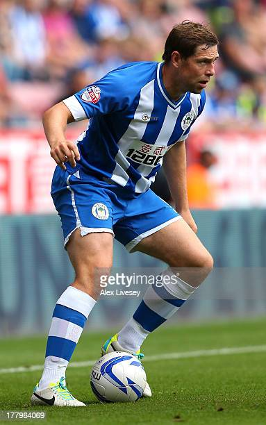 Grant Holt of Wigan Athletic controls the ball during the Sky Bet Championship match between Wigan Athletic and Middlesbrough at DW Stadium on August...