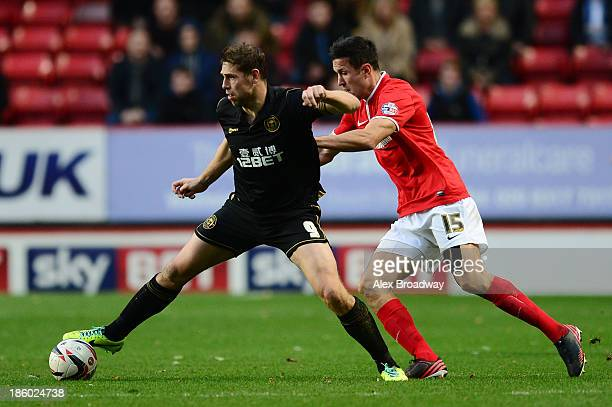 Grant Holt of Wigan Athletic holds off Richard Wood of Charlton Athletic during the Sky Bet Championship match between Charlton Athletic and Wigan...