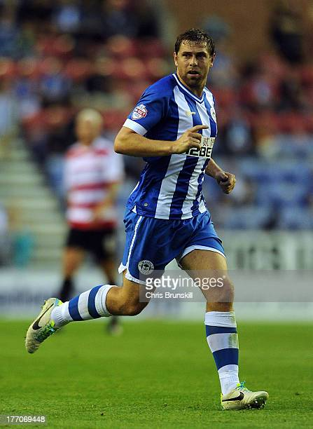 Grant Holt of Wigan Athletic in action during the Sky Bet Championship match between Wigan Athletic and Doncaster Rovers at DW Stadium on August 20...