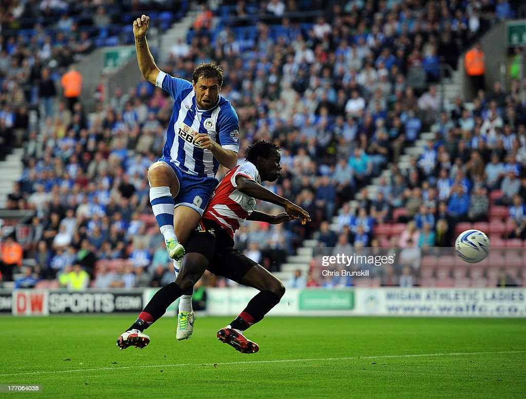 <a gi-track='captionPersonalityLinkClicked' href=/galleries/search?phrase=Grant+Holt&family=editorial&specificpeople=2091078 ng-click='$event.stopPropagation()'>Grant Holt</a> of Wigan Athletic in action with <a gi-track='captionPersonalityLinkClicked' href=/galleries/search?phrase=Bongani+Khumalo&family=editorial&specificpeople=4501463 ng-click='$event.stopPropagation()'>Bongani Khumalo</a> of Doncaster Rovers during the Sky Bet Championship match between Wigan Athletic and Doncaster Rovers at DW Stadium on August 20, 2013 in Wigan, England.