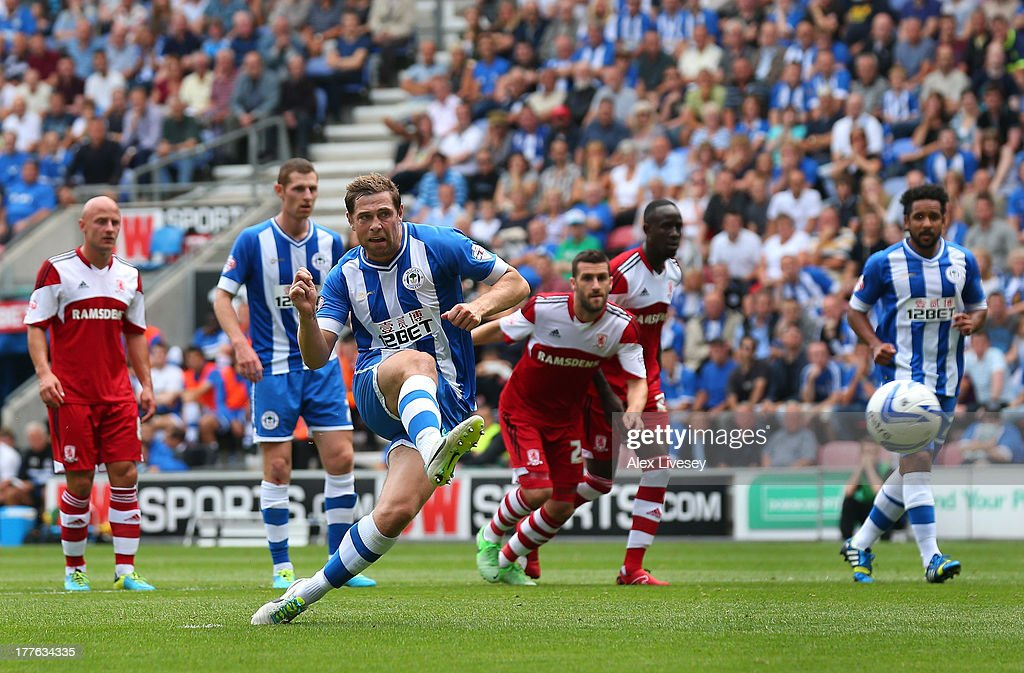 <a gi-track='captionPersonalityLinkClicked' href=/galleries/search?phrase=Grant+Holt&family=editorial&specificpeople=2091078 ng-click='$event.stopPropagation()'>Grant Holt</a> of Wigan Athletic scores the opening goal from the penalty spot during the Sky Bet Championship match between Wigan Athletic and Middlesbrough at DW Stadium on August 25, 2013 in Wigan, England,
