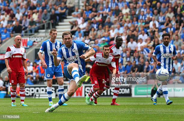 Grant Holt of Wigan Athletic scores the opening goal from the penalty spot during the Sky Bet Championship match between Wigan Athletic and...