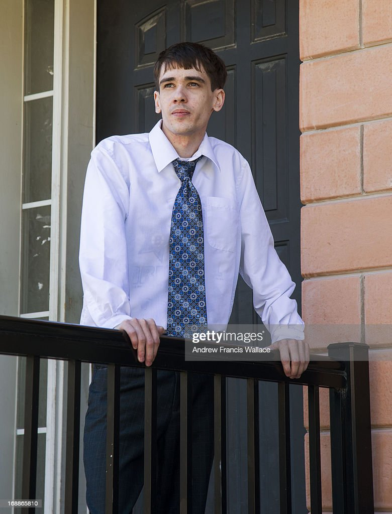 Grant Hutchinson poses outside his North York home. One student's HRTO complaint that he was discriminated against over his depression and anxiety raises questions over the delicate balance for post secondary education in tackling safety and mental health issues.