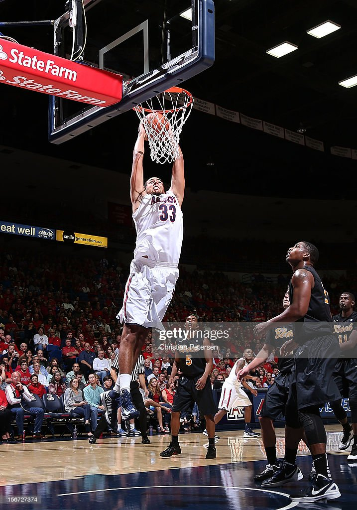 Grant Jerrett #33 of the Arizona Wildcats goes up for a slam dunk against the Long Beach State 49ers during the second half of the college basketball game at McKale Center on November 19, 2012 in Tucson, Arizona. The Wildcats defeated the 49ers 94-72.