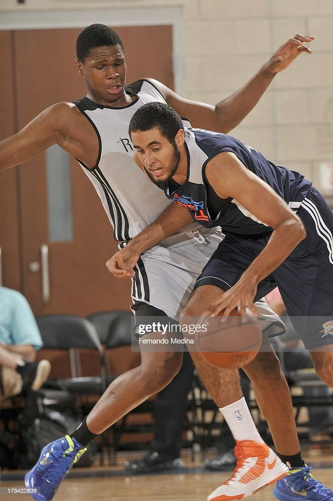 Grant Jerrett #47 of the Oklahoma City Thunder drives under pressure during the 2013 Southwest Airlines Orlando Pro Summer League game between the Oklahoma City Thunder and the Houston Rockets on July 12, 2013 at Amway Center in Orlando, Florida.