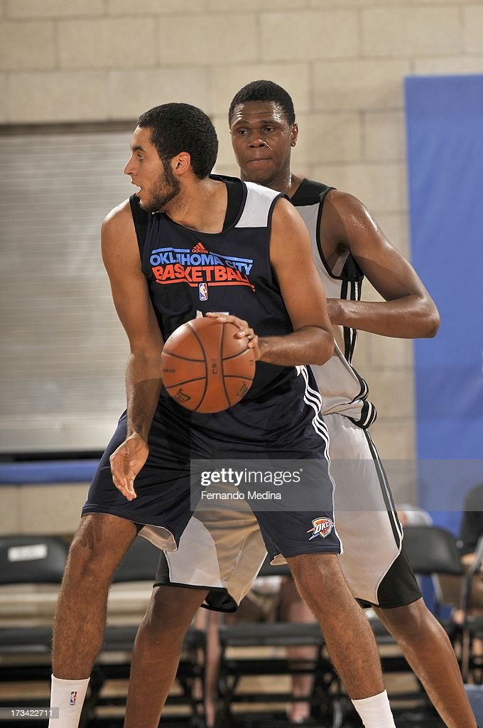 Grant Jerrett #47 of the Oklahoma City Thunder protects the ball during the 2013 Southwest Airlines Orlando Pro Summer League game between the Oklahoma City Thunder and the Houston Rockets on July 12, 2013 at Amway Center in Orlando, Florida.
