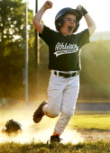 Grant Johnson of Central Springfield Little League celebrates as he runs to the home after a home run during a baseball game at Trailside Park May 5...