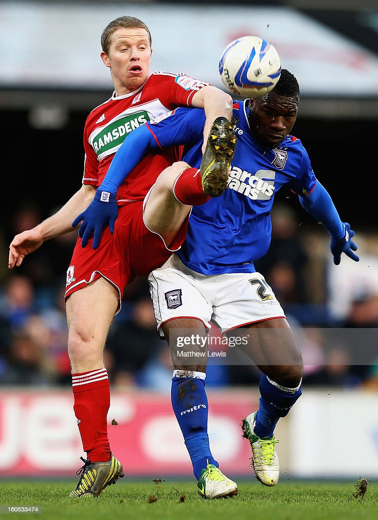 Grant Leadbitter of Middlesbrough and Aaron McLean of Ipswich challenge for the ball during the npower Championship match between Ipswich Town and Middlesbrough at Portman Road on February 2, 2013 in Ipswich, England.