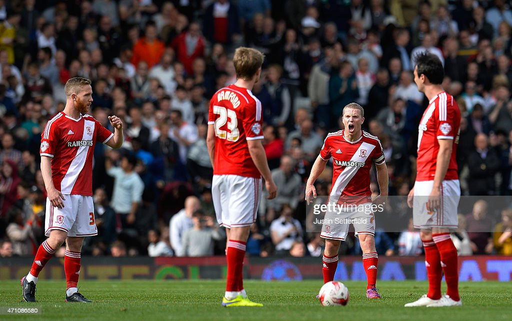 Grant Leadbitter of Middlesbrough FC urges on his team-mates Patrick Bamford of Middlesbrough FC and Kike of Middlesbrough FC after conceading Fulham's 3rd goal the Sky Bet Championship match between Fulham and Middlesbrough at Craven Cottage on April 25, 2015 in London, England.