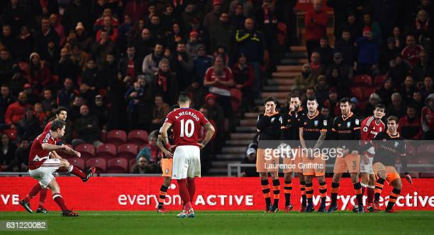 Grant Leadbitter of Middlesbrough scores his sides first goal from a free kick during The Emirates FA Cup Third Round match between Middlesbrough and...