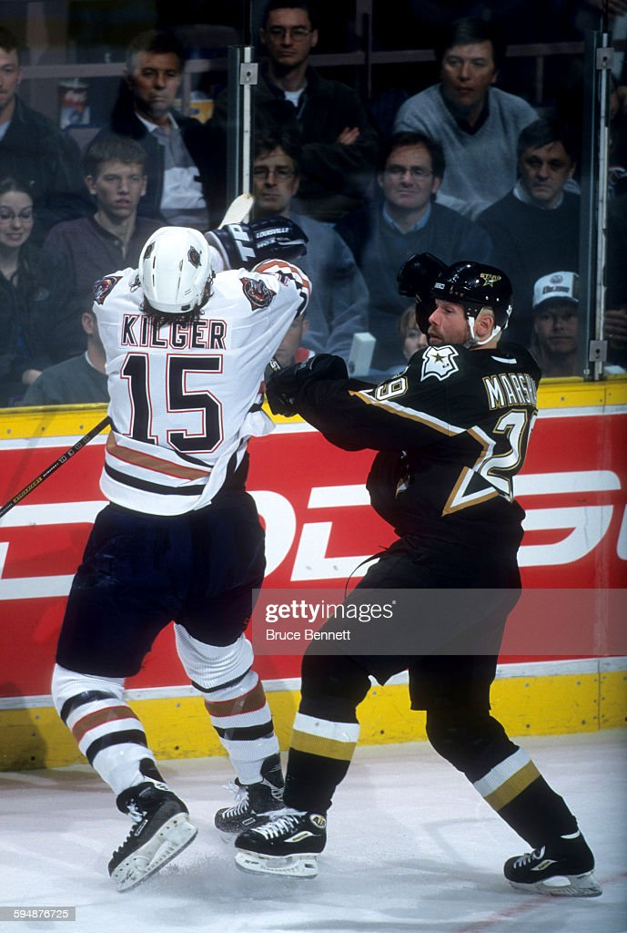 Grant Marshall of the Dallas Stars checks Chad Kilger of the Edmonton Oilers during Game 3 of the 2000 Conference QuarterFinals on April 16 2000 at...