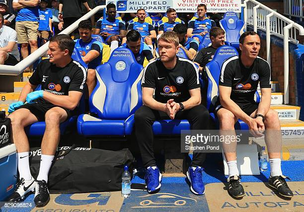 Grant McCann manager of Peterborough United looks on from the bench prior to the Sky Bet League One match between Peterborough United and Blackpool...