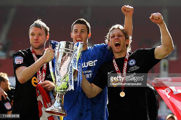 Grant McCann Tommy Rowe and Craig MackailSmith of Huddersfield the three goal scorers celebrate with the trophy after winning the npower League One...