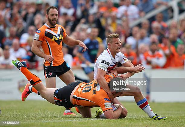 Grant Millington of Castleford Tigers dives over the line to score their first try during the First Utility Super League match between Wakefield...