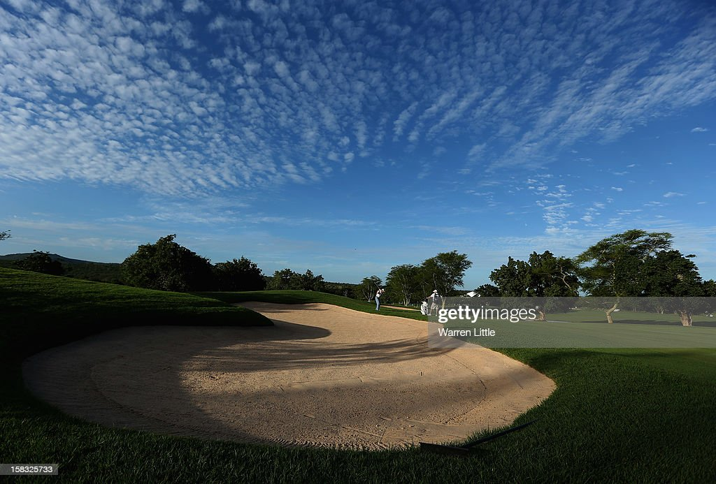 Grant Muller of South Africa plays his second shot on the 18th hole during the first round of the Alfred Dunhill Championship at Leopard Creek Country Golf Club on December 13, 2012 in Malelane, South Africa.